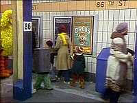 Christmas Eve on Sesame Street scene with Oscar (in garbage can) and Big Bird at the 86th Street New York City Subway station