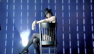 """White Lies (Paul van Dyk song) - Jessica Sutta wearing a burlesque black outfit in the video for """"White Lies""""."""