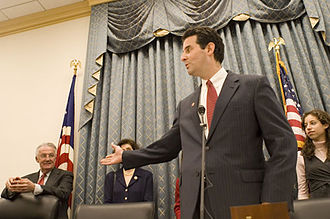 John Sarbanes - John Sarbanes at his swearing-in ceremony gesturing towards his father on the far left, former Senator Paul Sarbanes