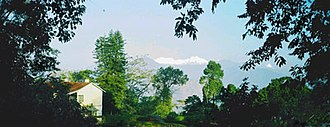 Kalimpong - Most large houses in Kalimpong were built during the British era. In the background is Mount Kangchenjunga.