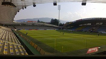 Ljudski vrt stadium with Mount Pohorje in the background.