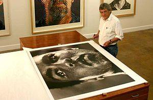 "Michael Brennan (photographer) - Michael Brennan in November, 2011 with a print of his photo ""1977"""
