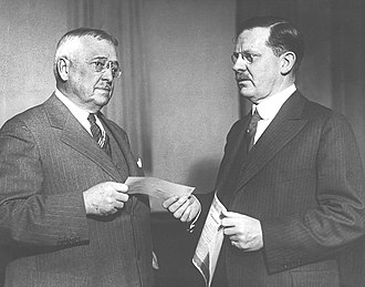 Graybar - Graybar president Albert L. Salt (left) presents $3 million check to Western Electric president Edgar S. Bloom, as Graybar employees' down payment toward the purchase of their company in 1929.