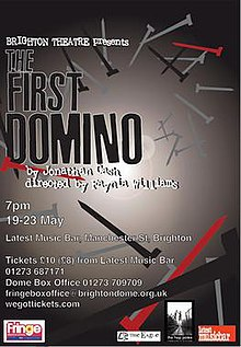 "Theatrical poster for the play ""The First Domino""; text shows the dates 19–23 May and location of Brighton theatre with details, overlaid on a stylised scattering of nails, in shades of grey and some in red"