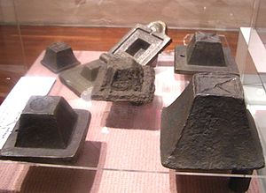 Tin ingot - Malaccan tin ingots in the National History Museum of Kuala Lumpur.