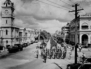 Townsville - Parade of 31st Battalion, Kennedy Regiment, marching down Flinders Street, Townsville, Queensland, 1937