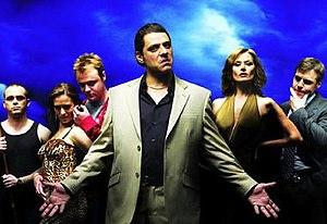 Underbelly (series 1) - A promotional image of the cast of Channel Nine's Underbelly. From left to right: Jason Moran (Les Hill), Roberta Williams (Kat Stewart), Carl Williams (Gyton Grantley), Alphonse Gangitano (Vince Colosimo), Danielle McGuire (Madeleine West) and Steve Owen (Rodger Corser).