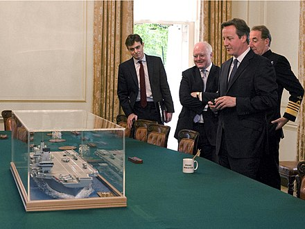 A model of a Queen Elizabeth-class aircraft carrier in the Cabinet Room of 10 Downing Street on 16 July 2015.