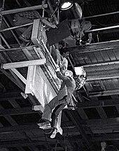 Alan Rickman hanging from a raised platform