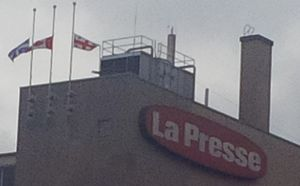 Paul Desmarais - The Canadian, Québec and Montréal flags half-masted in honour of Mr. Desmarais, at the La Presse building in Montréal.