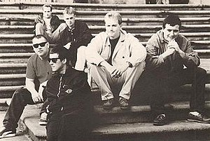 The Farm (British band) - Promotional photograph of The Farm in 1992  L to R: Ben Leach, Carl Hunter, Roy Boulter, Keith Mullin (back row), Steve Grimes and Peter Hooton (front row)