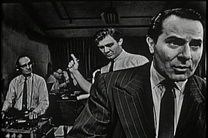 Golden Age of Television - The Night America Trembled was Studio Ones September 9, 1957, top-rated television recreation of Orson Welles' radio broadcast of The War of the Worlds on October 30, 1938. Alexander Scourby is seen in the foreground. Warren Beatty, in one of his earliest roles, appeared in the bit part of a card-playing college student.