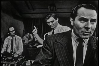Golden Age of Television - The Night America Trembled was Studio Ones September 9, 1957, top-rated television recreation of Orson Welles' radio broadcast of The War of the Worlds on October 30, 1938. Alexander Scourby is seen in the foreground. Warren Beatty (not pictured), in one of his earliest roles, appeared in the bit part of a card-playing college student.