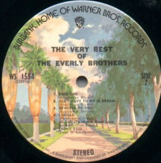 "Warner Bros. Records - The Warner Bros. ""Burbank"" picture label introduced in 1973. It was later modified when a banner was added across the WB Shield, on which the word ""RECORDS"" was inscribed."