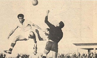 Ammo Baba - Ammo Baba in full flight against Al-Maslaha's Mohammed Thamir during match in 1959.