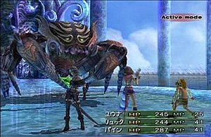 Final Fantasy X-2 - A battle with an early boss, depicting the characters' default dresspheres