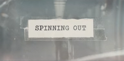 Spinning Out Title Card.png