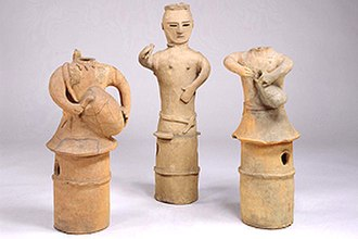 Taiko - Haniwa, dated to the 6th century CE.  The left and right depict two drum performers.  The statue on the left, depicted using a stick on a barrel-shaped drum, represents the earliest evidence of taiko usage in Japan.