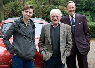 Del Boy - James Buckley (left) as a young Del Boy, alongside David Jason and Nicholas Lyndhurst on the set of Rock & Chips
