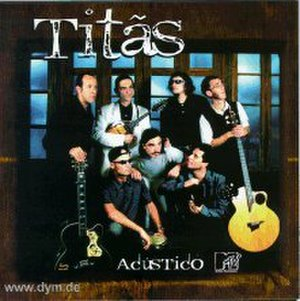 Titãs - Titãs, as depicted in their MTV Unplugged album. Standing, from left to right: Marcello Fromer, Paulo Miklos, Branco Mello and Nando Reis. Sitting, from left to right: Sergio Britto, Charles Gavin and Tony Bellotto.