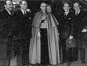 Eugenio Pacelli's 1936 visit to the United States - Pacelli (center), before his meeting with President Roosevelt in Hyde Park, New York, with (left to right): Count Enrico Galeazzi, Joseph P. Kennedy, Sr., Bishop Stephen Donahue, Marvin H. McIntyre, and Frank Comerford Walker.