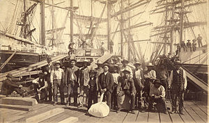 History of Squamish and Tsleil-Waututh longshoremen, 1863–1963 - Squamish Longshoremen, Moodyville Sawmill, Vancouver, Canada, 1889. According to Vancouver Archives, Squamish longshoreman William Nahanee is pictured in front-centre with laundry bag; the original caption erroneously identified him as Chinese.