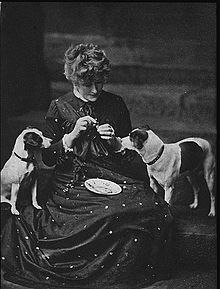with her pets, Fussie and Drummie in the 1880s