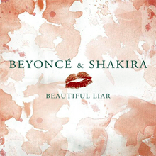 "The words ""Beyoncé & Shakira"", a lipstick mark and the phrase ""Beautiful Liar"" are placed on a surface with red spots throughout."
