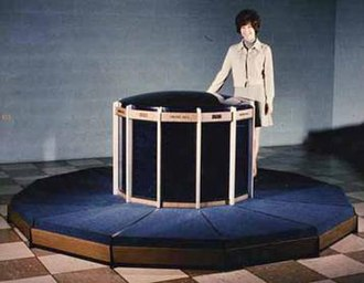 """CDC 8600 - The CDC 8600, likely a mock-up made for promotional purposes. The ring of """"benches"""" around the outside contains the power supplies—a design element that Cray re-used on the Cray-1. Each of the pie-wedges of the computer can be removed for servicing, and heat exhausts through the central core."""