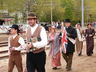 Fort Edmonton Park - Costumed staff from various eras partake in a parade (as seen on 1905 Street).