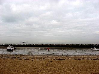 Herne Bay - The coast in Herne Bay, showing a few boats in the mud after the tide went out.