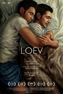 An image of Shiv Pandit and Dhruv Ganesh embracing in a bed.