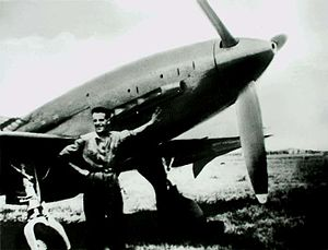 Reggiane Re.2005 - Mechanic Bruno Ferrari posing beside a Re.2005 at Reggio Emilia airfield c. 1944/45.