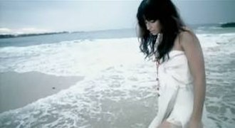 """All Good Things (Come to an End) -  Furtado walking in a seashore in the music video for """"All Good Things (Come to an End)""""."""