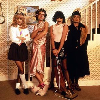 I Want to Break Free - The musicians dressed as female characters from Coronation Street. Left to right: Roger Taylor (as Suzie Birchall), Brian May (Hilda Ogden), Freddie Mercury (Bet Lynch) and John Deacon (Ena Sharples).