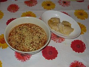 Cooked instant noodle served with chicken