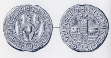 Photo of two ancient silver circular seals of Aimery, with non-Latin words framing the outer part of the seals.