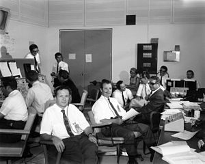 Thomas J. Kelly (aerospace engineer) - Tom Kelly and Owen Maynard (center) in the Spacecraft Analysis Room (SPAN) during the flight of Apollo 11