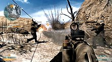 Three men wielding guns walk up a dirt ridge towards an explosion of dust.