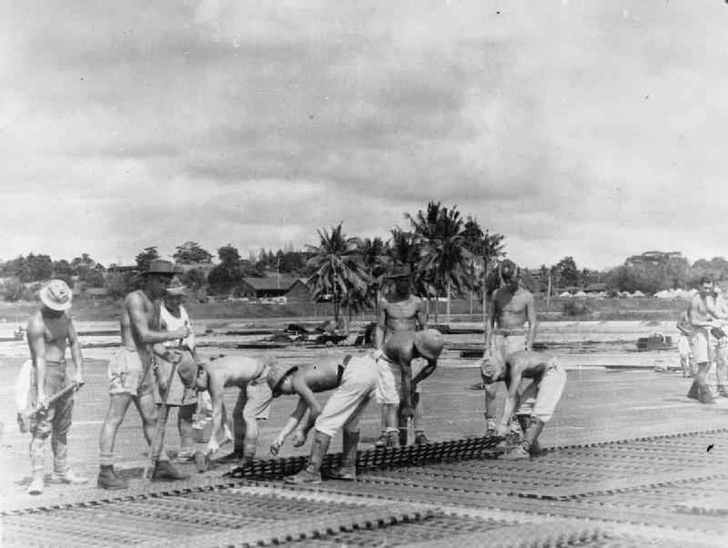 RAF 5353 Airfield Construction Wing and Japanese POWs improving runway of RAF Changi in 1946