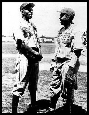 Satchel Paige - Paige (left) and Jackie Robinson in the uniform of the Kansas City Monarchs, 1945