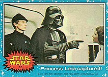 A Star Wars Topps Trading Card from the original 1977 film depicting Darth Vader confronting Princess Leia Organa