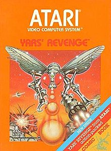 "Artwork of a orange, vertical rectangular box. The top half reads ""Atari Video Computer System"" and below ""Yars' Revenge"". The bottom half displays a drawn image of a silver robotic fly in battle. On the bottom-right corner there is a tricolor ribbon that says, ""New inside. Yars' Revenge from Atari action-packed comic book""."