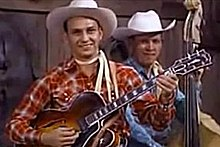 Byrd performing with Ernest Tubb's band in the 1950s (still frame from film clip)