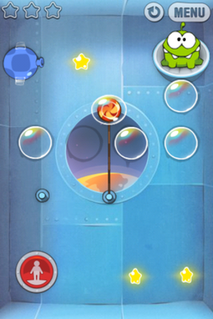 Cut the Rope - A level of Cut the Rope. The candy floats in a bubble, which can be popped with a touch or blown to the right with the blue bellows. The red button reverses the direction of gravity.