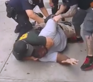 Death of Eric Garner - A screenshot of Garner tackled by the police