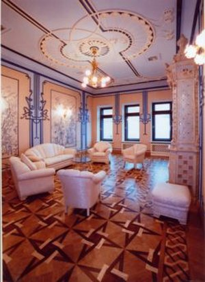 House with Chimaeras - A furnished interior room seen with elaborate decorations