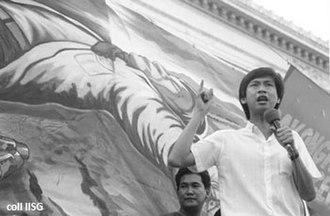 Leandro Alejandro - Lean Alejandro (standing with a microphone) during a students' protest against Marcos