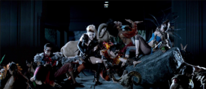 "Can't Be Tamed (song) - Cyrus bears a black leotard with birdlike accessories as she performs, surrounded by numerous costumed dancers, on a museum exhibit in the music video for ""Can't Be Tamed""."