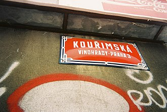 """Districts of Prague - The writing on this Prague street sign indicates it is in the Vinohrady cadastral area and in the """"old"""" district Prague 3."""